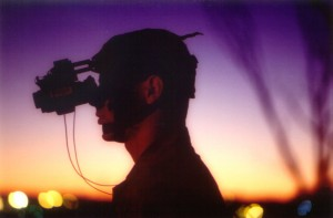 Soldier wearing night vision goggles at dusk