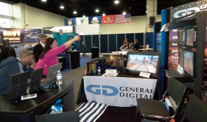 A visitor playing with the Playstation 3 Move System in our booth at the 2012 Navy League Expo