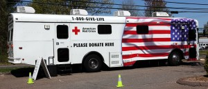 The American Red Cross Save-A-Life bus in General Digital's parking lot