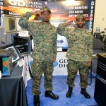 Tenell & Brian saluting at the 2015 Navy League Sea Air Space Expo