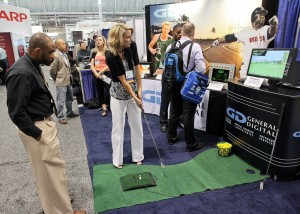 Jennifer demonstrates her golfing talents in our booth
