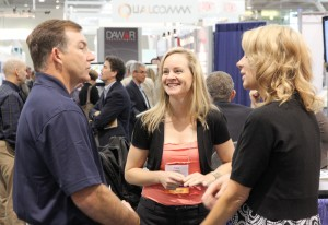 Tracy and Jennifer talk shop with a visitor to our booth