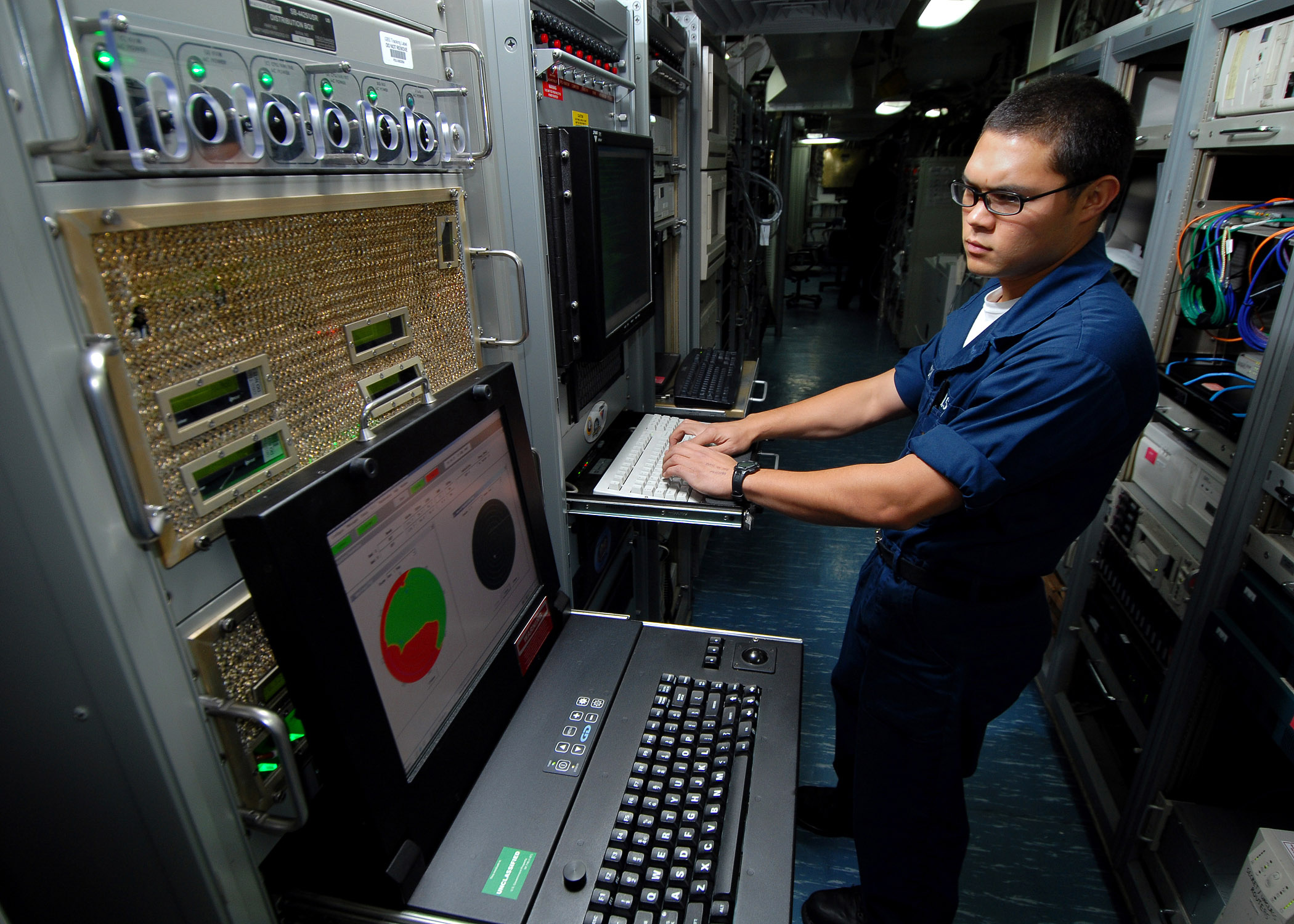 A Navy seaman monitors the ship's Automated Digital Networking System using general Digital rack mount displays
