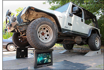Full weight of Jeep supported by two General Digital LCD monitors