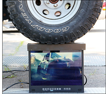 Full weight of Jeep resting on top of General Digital LCD monitor